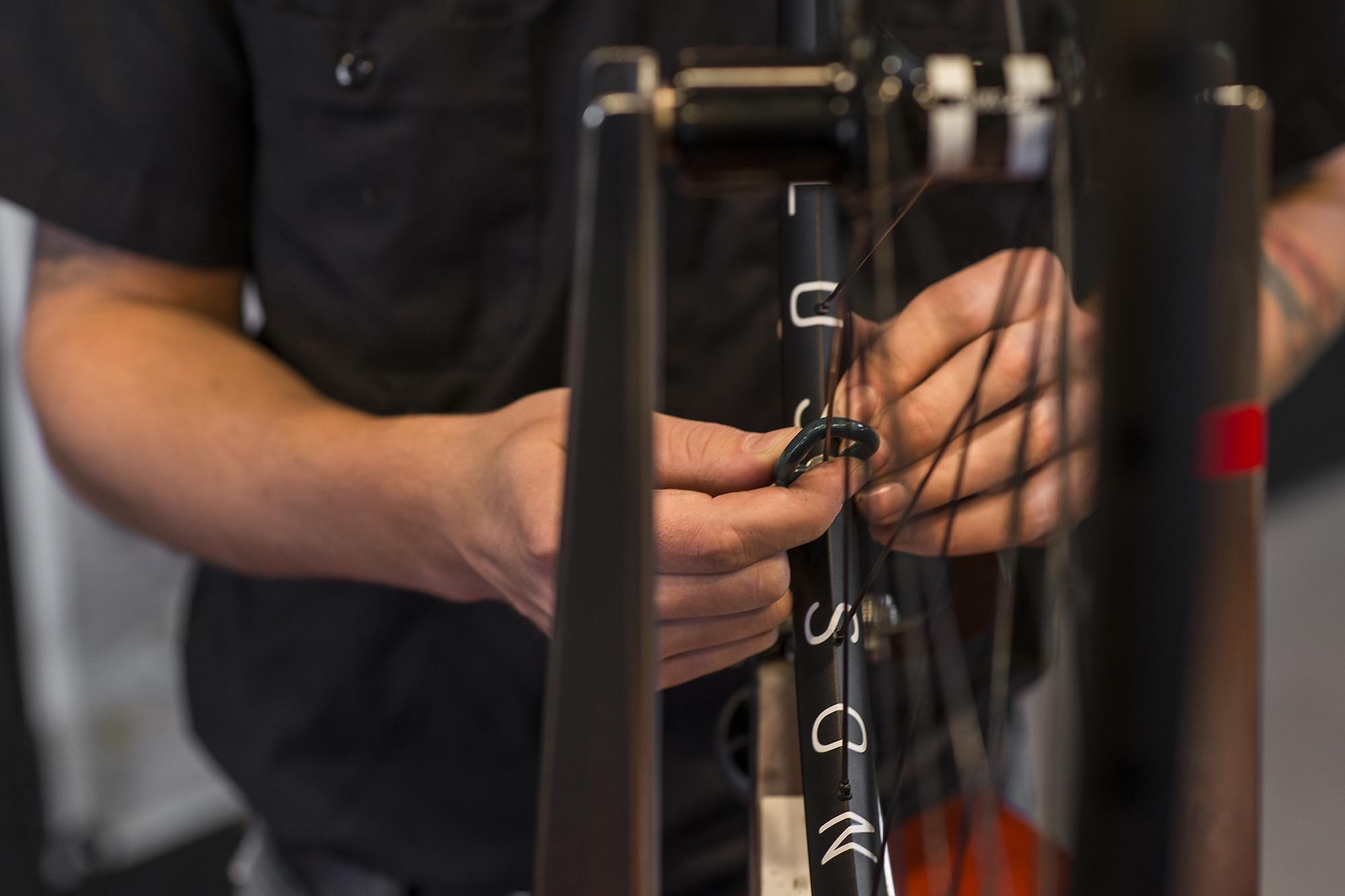 Bike Works tuning a wheel